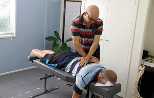 Chiropractor Dr David Malone performs chiropractic technique