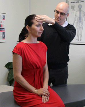 Chiropractor Dr David Malone examining a client