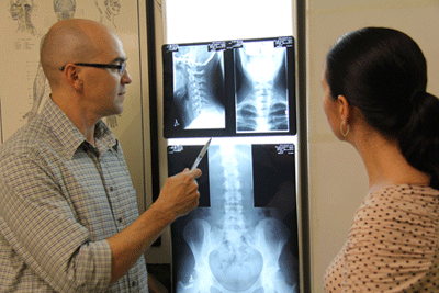 Chiropractor Dr Malone explaining findings to client